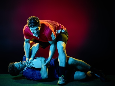 Rugby Players Wrestle for Ball