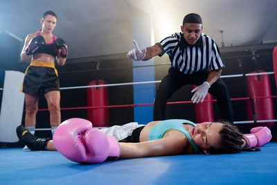 Female Boxers Referee Counting